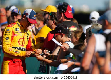 July 12, 2019 - Sparta, Kentucky, USA: Joey Logano (22) signs autographs before qualifying for the Quaker State 400 at Kentucky Speedway in Sparta, Kentucky.