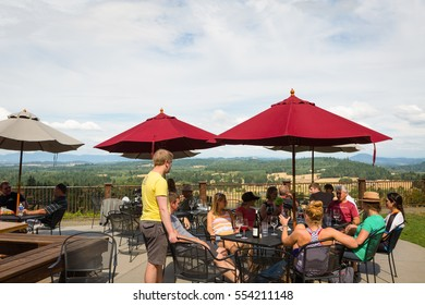 July 13, 2015.  Sarver Winery, Eugene, Oregon, USA.  Friends and family gather at Sarver Winery to enjoy boutique wines and the view of the southern Willamette Valley.