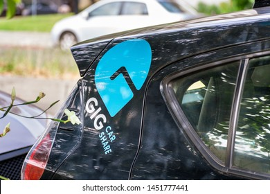 July 13, 2019 Berkeley / CA / USA - GIG Car Share is a carsharing service from AAA, in San Francisco Bay Area; The company operates a fleet of Toyota Prius Hybrid vehicles and all-electric Chevy Bolts