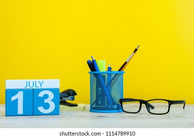 July 13th. Image of july 13, calendar on yellow background with office supplies. Summer time. With empty space for text