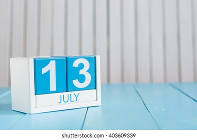 July 13th. Image of july 13 wooden color calendar on white background. Summer day. Empty space for text