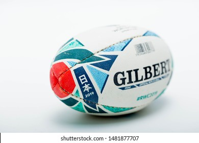 July 14, 2019 : Malaysia - Malacca. Close up of a Mini Official Replica Rugby Ball by Gilbert for the Rugby World Cup Japan 2019.  Isolated on white background, promo product shot.