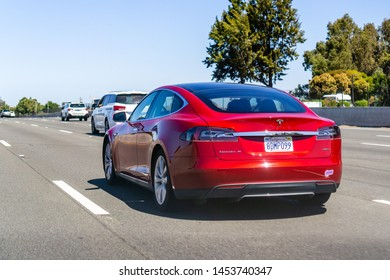 July 14, 2019 Mountain View / CA / USA - Tesla Model P85D driving on the freeway; south San Francisco bay area, California