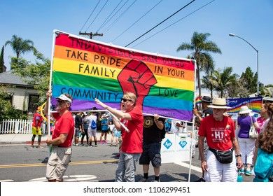 July 15, 2017, SAN DIEGO, CALIFORNIA, USA, Members of the Hillcrest Chapter of Indivisible Hold up their Flag and Prepare to March in the San Diego LGBT Pride Parade in the Hillcrest Neighborhood