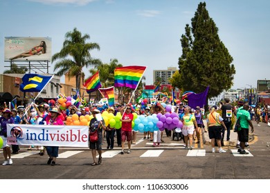 July 15, 2017, SAN DIEGO, CALIFORNIA, USA, Holding Human Rights Campaign and Rainbow Pride Flags, Indivisible Marches down the San Diego LGBT Pride Parade Route in the Hillcrest Neighborhood