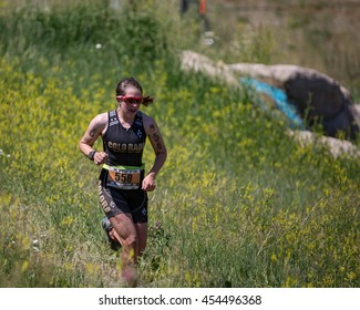 July 16, 2016 - Beaver Creek, Colorado, USA: Tess Amer of the University of Colorado runs to a win in the women's  25-29 age group at the XTERRA Beaver Creek Mountain Championship.
