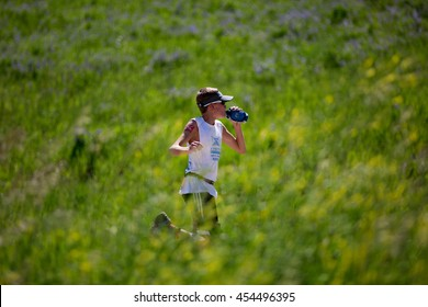 July 16, 2016 - Beaver Creek, Colorado, USA: A runner stays hydrated during the XTERRA Beaver Creek Mountain Championship.