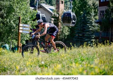 July 16, 2016 - Beaver Creek, Colorado, USA: World Champion Josiah Middaugh bikes toward T2 during the XTERRA Beaver Creek Mountain Championship.
