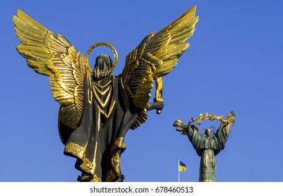 July 16, 2017 - Kiev, Ukraine:   Monument to the Archangel Michael and Independence Monument on the Maidan Nezalezhnosti.