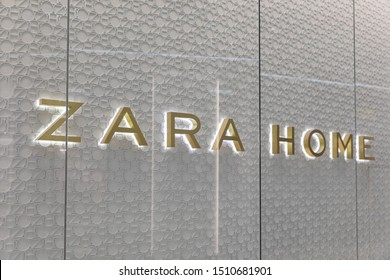 July 16, 2019: Zara Home logo in golden letters with backlighting on gray abstract background at Dana mall in Minsk. Zara Home is a company that belongs to the Spanish Inditex group dedicated to the