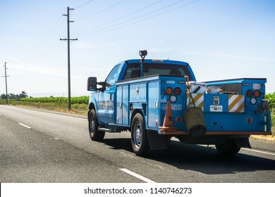 July 17, 2018 Gilroy / CA / USA - PG&E service vehicle driving on the freeway