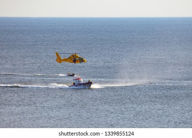 July 18, 2017 - Egmont aan Zee, Netherlands: a man is abseiling from a helicopter to the sea during a rescue drill of the dutch coastguard