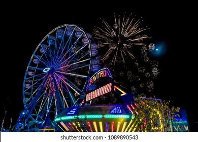 July 18, 2017 VENTURA CALIFORNIA - Illuminated ferris wheel with neon lights and fireworks at the Ventura County Fair, Ventura, California