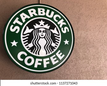 July 18 2018 - Salt Lake City Utah: close up view of the Starbucks sign and siren logo placed against a brown wall. Extra copy space for your message.
