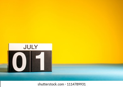 July 1st. Image of july 1, calendar on yellow background with empty space for text. Summer time