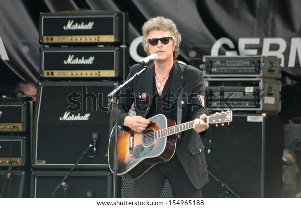 """JULY 2, 2005 - BERLIN: Wolfgang Niedecken at a concert of the German band """"BAP""""  at the Open Air festival """"Live 8"""", Strasse des 17. Juni, Berlin."""
