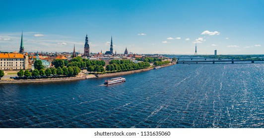 July 2, 2018. Riga, Latvia. Aerial view of Riga city - capital of Latvia. Amazing view on the river Daugava, old town, national library, bridges over the river and the main TV tower.