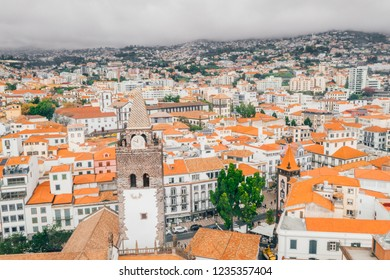 July 20, 2018. Funchal, Madeira, Portugal. Aerial view of the Funchal old town - the capital of Madeira island during cloudy weather by the Atlantic ocean.