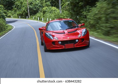 July 2007, Nakhon Ratchasima, Thailand : Selective focus of Red Lotus Exige test drive on mountain.