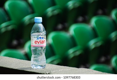 JULY 2013 - LONDON, UK: A bottle of EVIAN mineral water surrounded by the seats at Wimbledon tennis court.