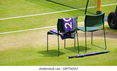 JULY 2013 - LONDON, UK: Wimbledon souvenir stuff at the side of the tennis court with two chairs.