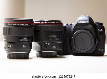 July 2014: Canon Luxury lenses 35mm and 85mm with a digital EOS camera aside.