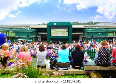 JULY 2014 - LONDON, UK: A crowd of people watched Tennis Wimbledon Championship Final round through the screen on the ground around the centre court.