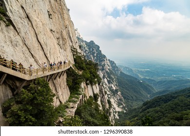 July 2016 – Dengfeng, China – Tourists walk on Mount Songshan, the tallest of the 5 sacred mountains of China dedicated to Taoism that stands above the famous Shaolin temple in Henan Province