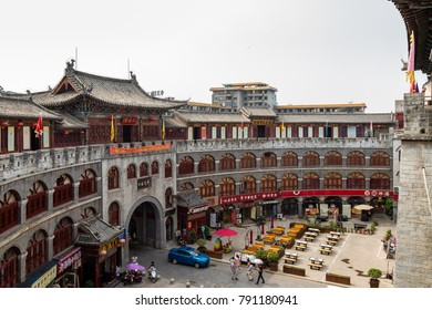 July 2016 - Luoyang, China - Lijing gate seen from the inside, ful of shops and restaurants. The fortified gate marks the entrance to the old city of Luoyang in Henan province, China