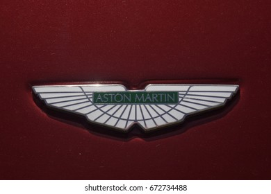 July 2017- The badge on the bonnet of a Aston Martin sports saloon at a classic car show in Pembrey Country Park near Llanelli, Carmarthenshire, Wales, UK.