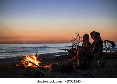 July, 2017 Camping in front of bonfire by the Baltic sea