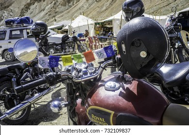 July 2017, highway between Manali and Leh, India, Ladakh, Royal Enfield motorbikes are parked on the side of the road , with the helmets resting on the mirrors