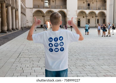 July, 2017. Krakow. Poland. Wawel on the river. Castle. Boy teenager in a T-shirt with logos of social networks Twitter, Facebook, Snapchat, Instagram, Blogger, Linkedin.
