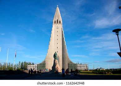 "JULY 2017 - REYKJAVIK: a sculpture/ bust of Leifur the Lucky and the ""Hallgrimskirkja"" (Hallgrims Church), Reykjavik, Iceland."