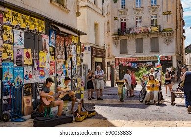 July 2017, Theater festival of Avignon, France. Two artists playing guitar in the street