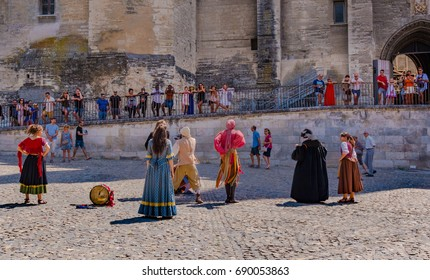 July 2017, Theater festival of Avignon, France. Theater troupe playing a piece in front of the Palais des Papes