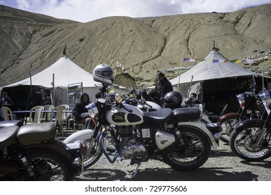 July 2017,Indian Royal Enfield motorbikes parked outside tent tea stalls on the road between Manali and Leh, Ladakh