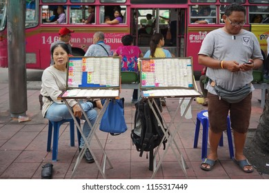july ,2018 : unidentified woman selling thai lottery at market , Bangkok,Thailand