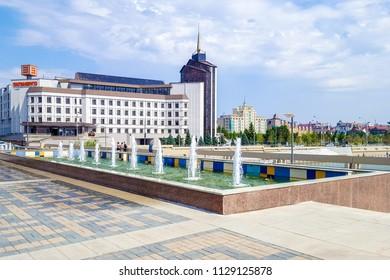 July 2018,Russian Federation, Tatarstan, Kazan.A cascade of fountains on lake Kaban and the adjacent square in front of the Galiaskar Kamal theatre. Sights Of Kazan.