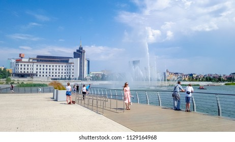July 2018,Russian Federation, Tatarstan, Kazan.A cascade of fountains on lake Kaban and the adjacent square in front of the Galiaskar Kamal theatre. Sights Of Kazan.Embankment.