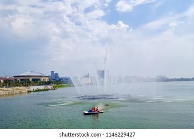 July 2018,Russian Federation, Tatarstan, Kazan.A cascade of fountains on lake Kaban and the adjacent square in front of the Galiaskar Kamal theatre. Sights Of Kazan.Embankment.