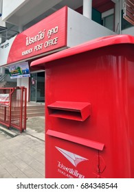 July 21, 2017: Red pillar box in front of Khukhot Post Office, Pathumthani,Thailand. it is a large red Square shape public mailbox.