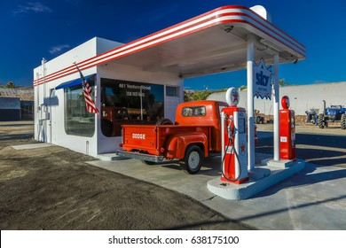 July 22, 2016 - Red Dodge Pickup truck parked in front of vintage gas station in Santa Paula, California