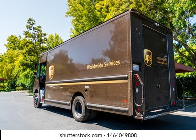 July 22, 2019 Sunnyvale / CA / USA - UPS (United Parcel Service) vehicle making deliveries in South San Francisco Bay area