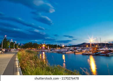 July 23 2017. Kelowna. British Columbia. Canada. Magic hour at Kelowna waterfront. Many visitors walked along the waterfront to admire the beautiful waterfront.