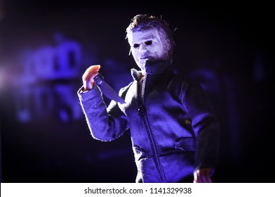JULY 23 2018: Recreation of a scene from the 1978 movie Halloween; Michael Myers (the shape) holding a knife in front of the Wallace house