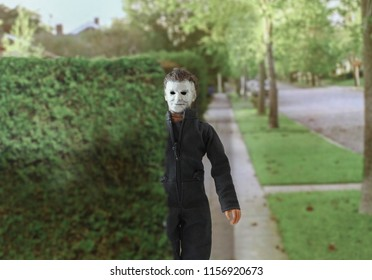 JULY 23 2018: Recreation of a scene from the 1978 movie Halloween; Michael Myers (the shape) hiding behind a hedge as he stalks his victims