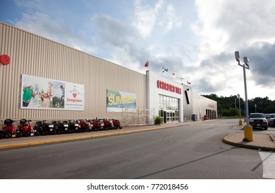 July 24, 2013 in New Minas, Nova Scotia, the Canadian Tire storefront with JumpStart campaign and lawn mowers