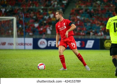 July 24, 2015- Shah Alam, Malaysia: Liverpool's Jordan Henderson dribbles the ball in a friendly match against the Malaysian Team. Liverpool Football Club from England is on an Asia tour.
