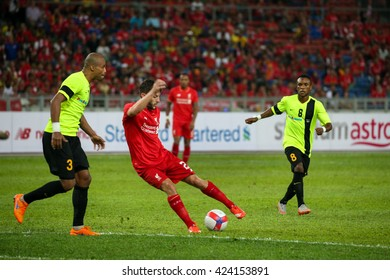July 24, 2015- Shah Alam, Malaysia: Liverpool's Adam Lallana (red) dribbles the ball in the friendly match against the Malaysian team. Liverpool Football Club from England is on an Asia tour.